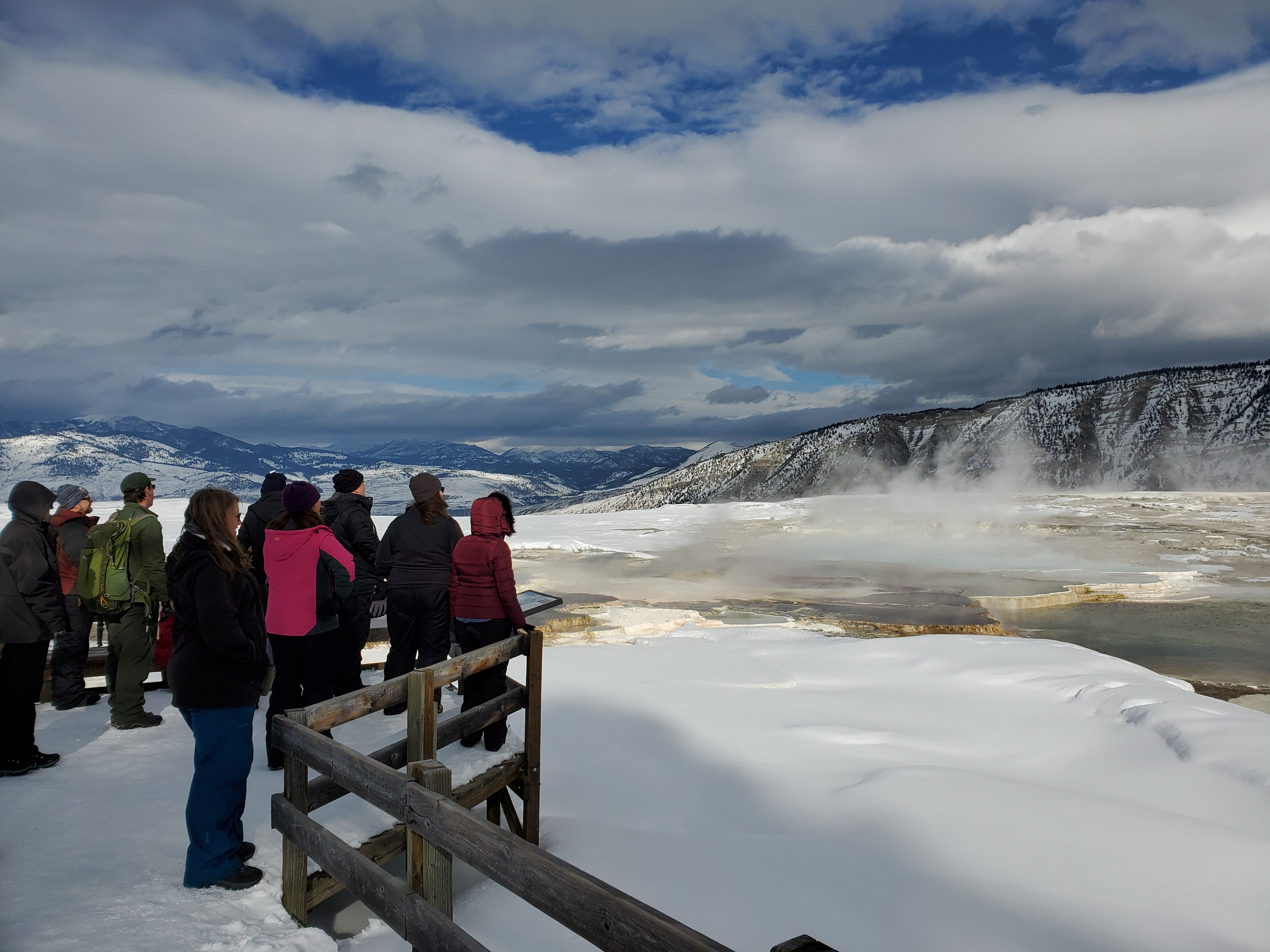 A group of people overlooking mammoth terraces
