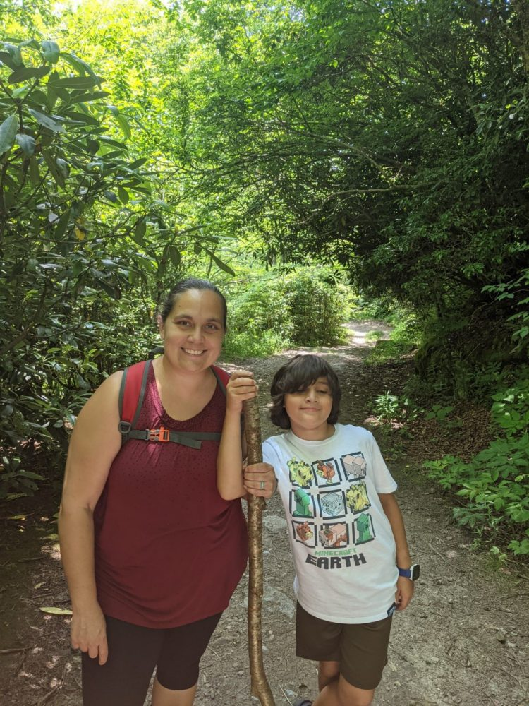 Teacher and her son hike in a mountain forest along the Blue Ridge Parkway