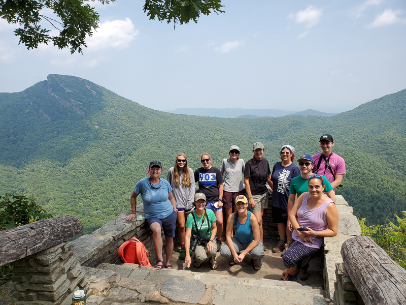 A spectacular group of NC Educators overlooking Table Rock from Wiseman's View in the Linville Gorge Wilderness Area.
